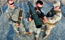 Voordeeltje bij de crisis: militaire uitgaven dalen