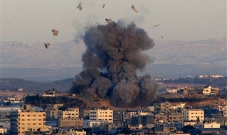 an Israeli bomb explodes in Gaza - Jim Forest