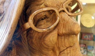 Wood sculpture--old woman at the Vesterheim visitor's center - rochelle hartman