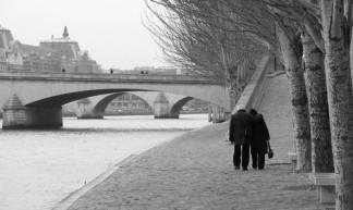 Old couple walking along the Seine - Daniel Racovitan