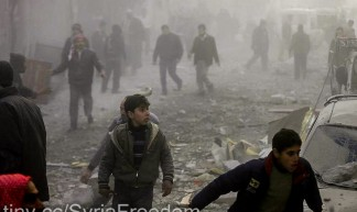 People in Douma rush away from the site of the airstrike