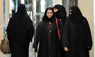 Saudi women walk inside the Faysalia shopping centre in Riyadh - Tribes of the World
