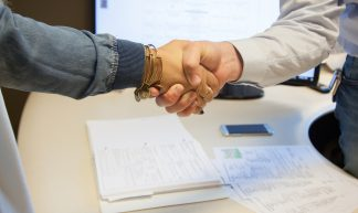 handshake sealing the deal - franchise opportunities