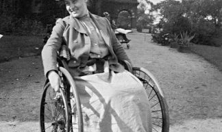 Edwardian polio girl in wheelchair - jackcast2015