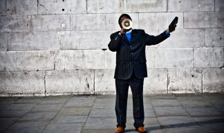 With A Megaphone By A Wall - Garry Knight