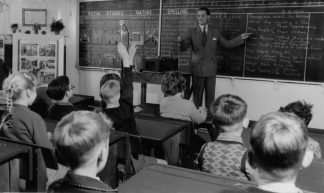 Teacher, Grade 3, preparing for film showing, 1954 - Public Record Office Victoria