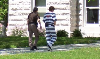 Prison inmate walking with guard - Jobs For Felons Hub